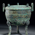 An inscribed archaic bronze tripod incense <b>burner</b> and cover, ding, Eastern Zhou dynasty