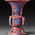 A rare blue and white iron-red-ground <b>archaistic</b> <b>vase</b>, zun, Jiajing six-character mark and of the period (1522-1566)