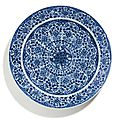 A blue and white '<b>Floral</b>' <b>dish</b>, Qing dynasty, Kangxi period (1662-1722)