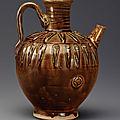 A dark amber-glazed ovoid ewer, Liao dynasty, <b>10th</b> <b>century</b>