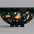 An exceptional and rare <b>black</b>-<b>ground</b> famille-verte 'chrysanthemum' bowl, mark and period of Yongzheng (1723-1735)