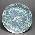 Dish with Chinese lion dog, Iran, <b>Safavid</b> Period (1501 - 1722)