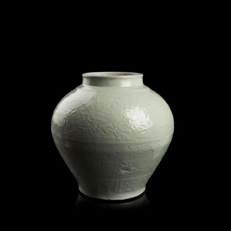 Rare white-glazed and carved 'dragon' jar, inscribed Run Yuan, late Yuan-early Ming dynasty