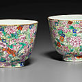 A rare pair of famille rose <b>Mille</b> <b>Fleurs</b> cups, Jiaqing six-character seal marks in iron red and of the period (1796-1820)
