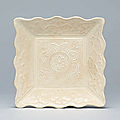 A small moulded white-glazed <b>square</b> <b>dish</b>, Liao Dynasty (907-1125)