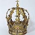Crown. Spain, ca. <b>1600</b>. Copper-gilt, pierced, set with enamelled silver bosses, enamelled gold rosettes and glass pastes