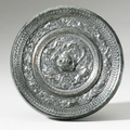 A bronze '<b>Spirits</b> of the Four Directions' mirror, Sui Dynasty