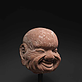 A rare <b>sandstone</b> head of a luohan, 14th-15th century