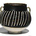 A ribbed <b>black</b>-<b>glazed</b> <b>jar</b>, Jin dynasty