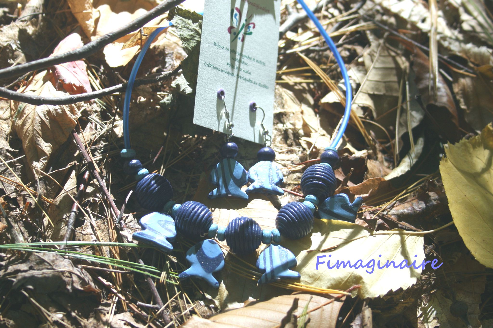 collier poissons bleus avec b.o. - 24$