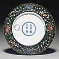 A rare yellow-enameled <b>famille</b> <b>noire</b> saucer dish, Yongzheng six-character mark and of the period (1723-1735)
