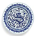 A large blue and white '<b>dragon</b>' <b>basin</b>, Qing dynasty, Qianlong period