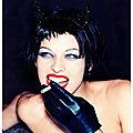 Milla Jovovich smokes - by Ellen von Unwerth