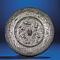 A large silvered bronze 'Beast and Grape' mirror, Tang dynasty (618-907)