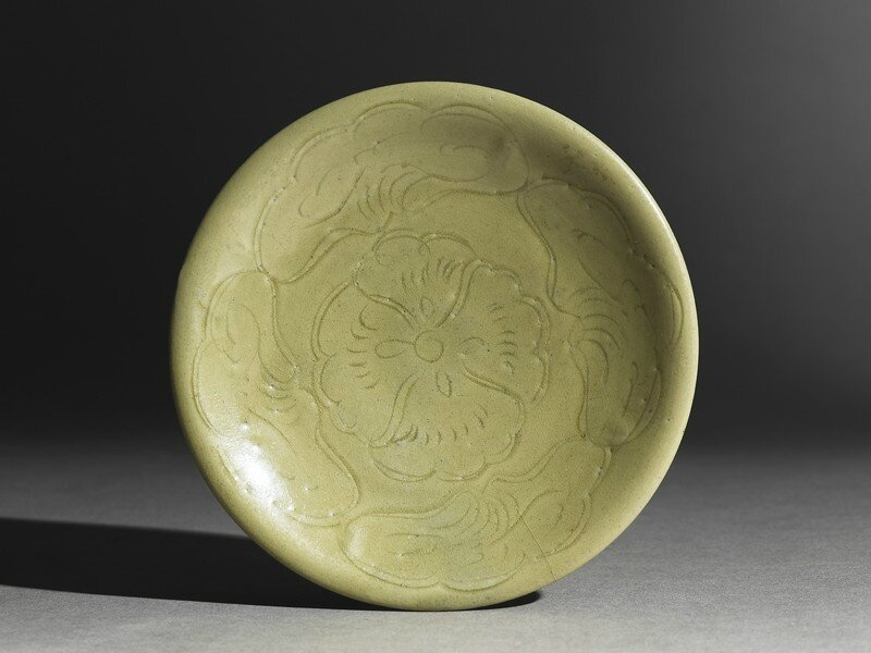 Greenware saucer dish with lotus leaves, Yue kiln-sites, late 9th century - early 10th century AD, Tang Dynasty