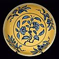 Plate with underglaze blue decoration of auspicious fruit branches over yellow ground. ming dynasty, zhengde mark and period