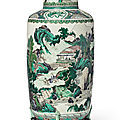 A rare <b>famille</b>-<b>verte</b> biscuit 'landscape' rouleau vase, Qing dynasty, Kangxi period (1662-1722)
