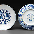 A pair of blue and white 'dragon and <b>phoenix</b>' dishes, Kangxi six-character marks and of the period (1662-1722)
