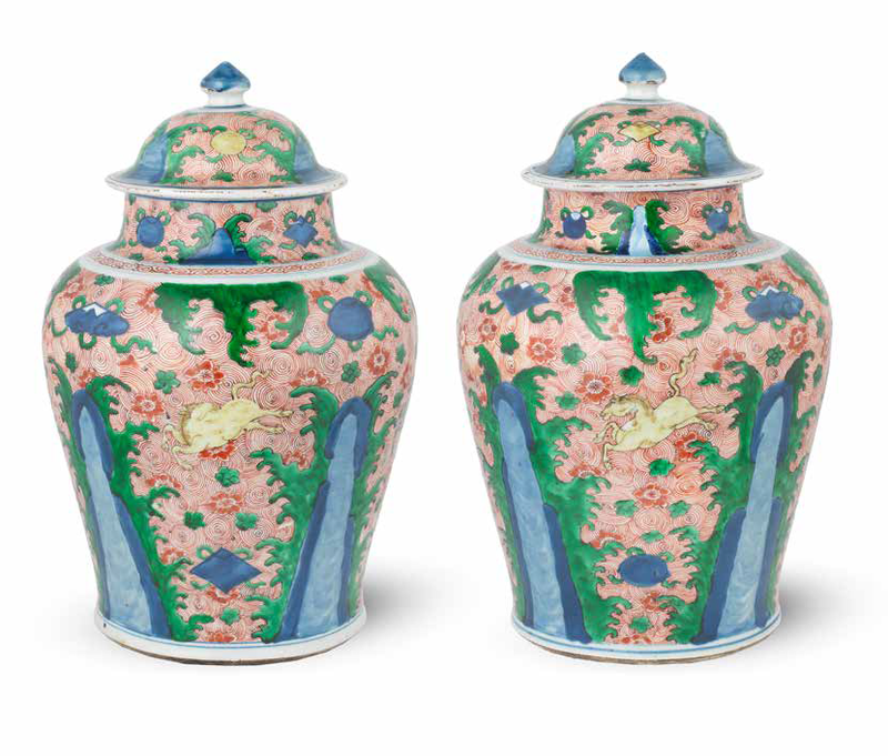 A pair of wucai 'galloping horse' jars and covers, Shunzhi (1644-1661)