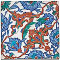 An Iznik polychrome pottery tile with interlacing split-palmettes and lotus blossoms, Turkey, <b>circa</b> <b>1570</b>