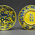 A rare pair of small <b>yellow</b>-<b>ground</b> blue and white lobed dishes, Jiajing six-character marks in underglaze blue and of the period