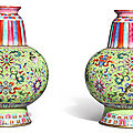 A pair of famille-rose green-ground <b>Tibetan</b>-<b>style</b> vases, bumpa, Jiaqing seal marks and period (1796-1820)