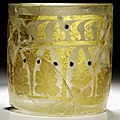 A blue enamelled gold-decorated <b>sandwich</b> glass beaker, probably Iran, 9th century