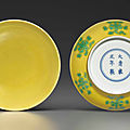 A fine pair of small <b>green</b>-<b>decorated</b> yellow-ground dishes, Yongzheng six-character marks and of the period (1723-1735)