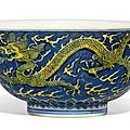 A <b>blue</b>-<b>ground</b> <b>yellow</b>-<b>enamelled</b> 'dragon' bowl, Kangxi six-character mark and of the period (1662-1722)
