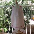 Robe trapèze en lin rose pâle 18m poche brodée double croquet