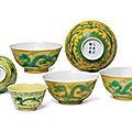 Three near pairs <b>of</b> yellow-ground green-enamelled 'Dragon' bowls, two pairs <b>of</b> bowls, <b>Guangxu</b> <b>six</b>-<b>character</b> <b>marks</b> <b>and</b> <b>period</b>