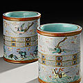 Two Extremely Rare Famille Rose 'Heaven and <b>Earth</b>' Revolving Brushpots, with Qianlong seal marks and dated to the period.