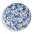 A large underglaze blue and copper-red 'fish' dish, qing dynasty, kangxi period (1662-1722)