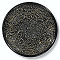 An exquisite black lacquer 'peony' dish. song dynasty