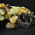 A superbly carved russet jade figure of a recumbent mythical beast, Ming dynasty or earlier