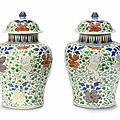 A pair of wucai 'boys' baluster jars and covers, kangxi period (1662-1722)