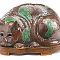 A Chinese Export <b>aubergine</b> <b>and</b> <b>green</b>-<b>glazed</b> biscuit 'Cat' night light, circa 1800