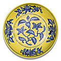 A yellow-ground <b>and</b> underglaze-blue 'Gardenia' dish, <b>Zhengde</b> <b>mark</b> <b>and</b> <b>period</b> (<b>1506</b>-<b>1521</b>)