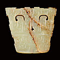 A <b>celadon</b> <b>jade</b> 'animal mask' plaque, Eastern Zhou dynasty, Spring and Autumn period (770-475 BC)