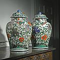 A large pair of Chinese famille-verte <b>baluster</b> <b>jars</b> <b>and</b> <b>covers</b>, Qing dynasty, Kangxi period