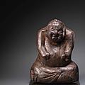 A very rare carved wood <b>seated</b> <b>figure</b>, Han Dynasty (206 BC-220 AD)