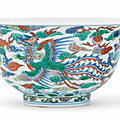 A rare pair of doucai 'dragon and phoenix' bowls, kangxi six-character marks and of the period (1662-1722)