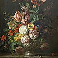 Jakob Bogdani, Roses, tulips, marigolds and other flowers in a <b>silver</b> <b>vase</b> on a marble ledge