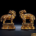 A Pair of Gilt-Bronze 'Qilin' Figures, <b>Xuande</b> Period, 1426-1435