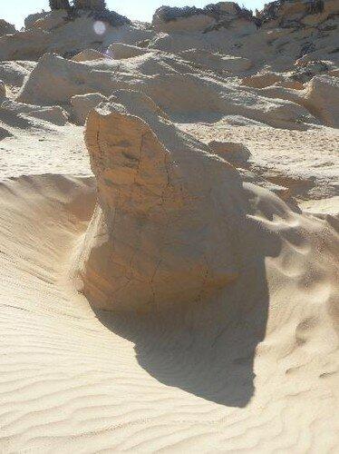 statue de sable sculpté par le vent