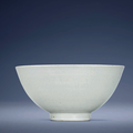 An early Ming white-glazed anhua-decorated bowl, Xuande six-character mark in underglaze blue within a double circle and of the period (1426-1435)