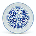 A large blue and white 'dragon' dish, <b>Jiajing</b> six-character mark in underglaze blue in a line and of the period (1522-1566)