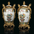 A pair of french ormolu-mounted Samson famille vert porcelain vases and covers. The mounts of <b>Louis</b> <b>XV</b> <b>style</b>, late 19th century