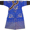A blue silk gauze dragon robe with couched gold thread dragon motifs and black cuffs, China, <b>Guangxu</b> <b>period</b>