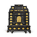 A South German gilt-metal mounted, ebonised and carved table cabinet, possibly Augsburg, early <b>17th</b> <b>century</b>